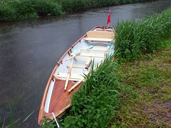 canoe(0.0), watercraft rowing(0.0), paddle(0.0), boats and boating--equipment and supplies(1.0), dinghy(1.0), vehicle(1.0), skiff(1.0), boating(1.0), watercraft(1.0), oar(1.0), boat(1.0),