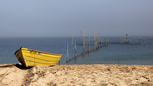 yellow fishing boat, foggy bay