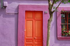 Orange door, pink house