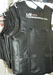 outerwear(0.0), pocket(0.0), textile(1.0), leather jacket(1.0), clothing(1.0), leather(1.0), jacket(1.0), vest(1.0),