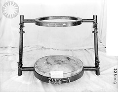 tom-tom drum(0.0), percussion(0.0), furniture(0.0), bass drum(0.0), snare drum(0.0), musical instrument(0.0), table(0.0), drums(0.0), drawing(0.0), drum(0.0), hand drum(0.0), timbales(0.0), skin-head percussion instrument(0.0), circle(1.0), black-and-white(1.0),
