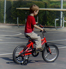 bicycle motocross(0.0), baby carriage(0.0), vehicle(1.0), training wheels(1.0), bmx bike(1.0), flatland bmx(1.0), sports equipment(1.0), cycle sport(1.0), bicycle(1.0),