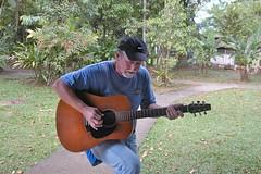 play a guitar