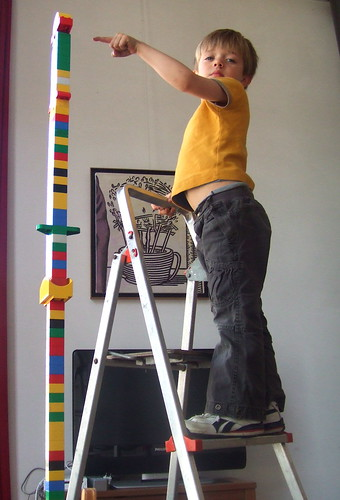 child building a lego tower