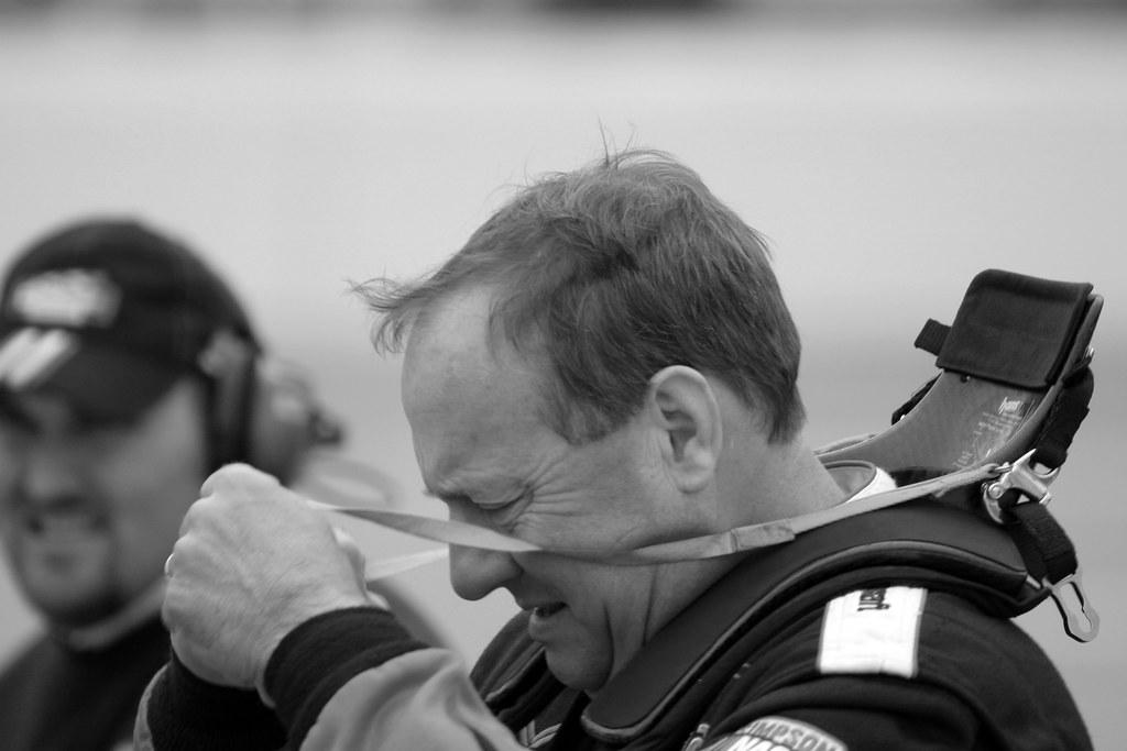 Ken Schrader unfastens his HANS device