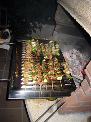 meal(0.0), outdoor grill(0.0), grilling(1.0), barbecue(1.0), meat(1.0), churrasco food(1.0), food(1.0), dish(1.0), cuisine(1.0), barbecue grill(1.0), cooking(1.0),