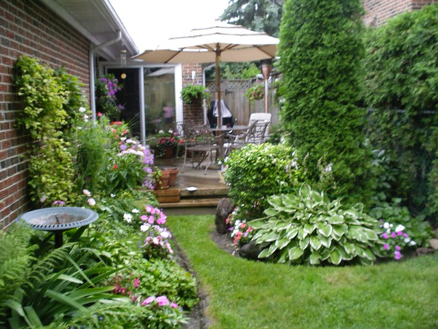 Our back yard garden in july 05 flickr photo sharing for Small garden design ideas with lawn