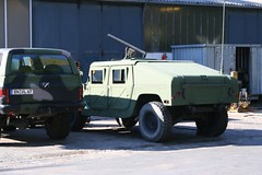 armored car, automobile, military vehicle, sport utility vehicle, vehicle, hummer h1, armored car, land vehicle, luxury vehicle, motor vehicle,