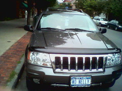 automobile(1.0), automotive exterior(1.0), sport utility vehicle(1.0), vehicle(1.0), jeep grand cherokee(1.0), crossover suv(1.0), bumper(1.0), land vehicle(1.0), vehicle registration plate(1.0),