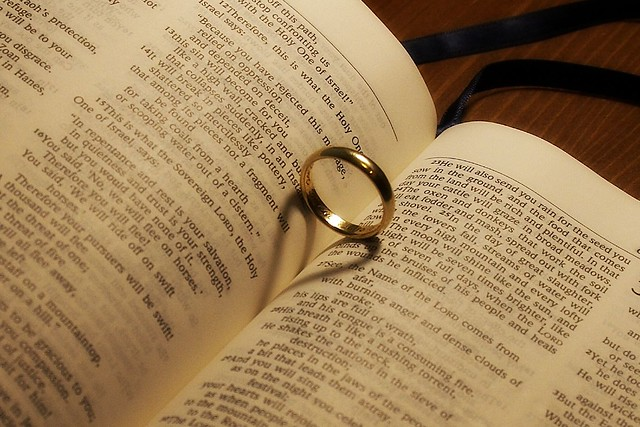 wedding ring in bible flickr photo
