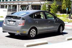 hatchback(0.0), automobile(1.0), automotive exterior(1.0), toyota(1.0), wheel(1.0), vehicle(1.0), compact car(1.0), bumper(1.0), sedan(1.0), toyota prius(1.0), land vehicle(1.0),