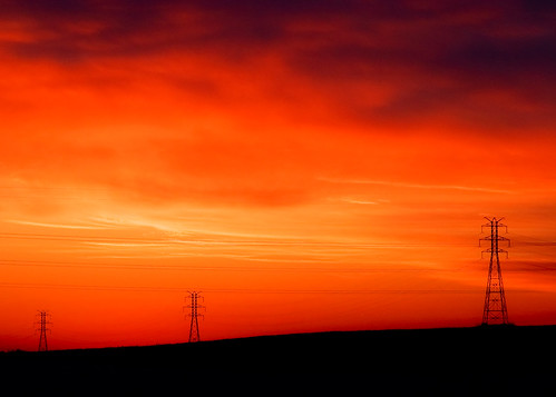 city morning light sunset red sky orange sun color colour tower industry lines silhouette horizontal wisconsin clouds sunrise landscape outdoors fire dawn evening soleil energy industrial glow technology power dusk ominous horizon utility nobody line pylon business growth powerlines madison future infrastructure electricity hanging orangesky suburbs backlit redsky copyspace dawning electrical dramaticsky hue wi transmission lattice distribution highvoltage electricitypylon powergrid stockphotography fitchburg transmissiontower energyconservation suspensiontower electricalcompany builtstructure electricalservice steellattice fitchburgwisconsin powerindustry electricaltransmissiontower toddklassy tdworld electricalenergyproduction