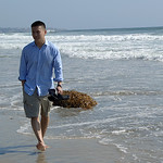 James strolls on the beach