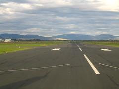 aircraft(0.0), aviation(0.0), highway(0.0), airplane(0.0), field(0.0), aerial photography(0.0), race track(0.0), flight(0.0), asphalt(1.0), road(1.0), plain(1.0), infrastructure(1.0), tarmac(1.0), runway(1.0),