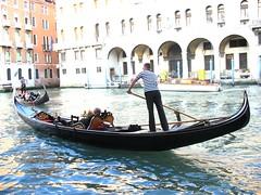 longship(0.0), viking ships(0.0), vehicle(1.0), rowing(1.0), watercraft rowing(1.0), boating(1.0), gondola(1.0), watercraft(1.0), boat(1.0), waterway(1.0),