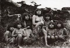 mythology(0.0), mud(0.0), child(1.0), tribe(1.0), people(1.0), photograph(1.0), monochrome photography(1.0), monochrome(1.0), black-and-white(1.0), person(1.0),