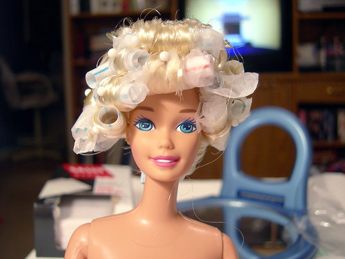Don't dolls look cute with their hair in rollers? Barbie does the beauty shop routine.