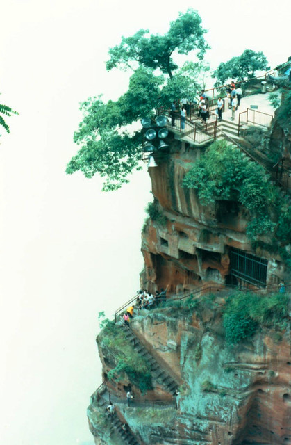 cloud touching cliff in Leshan