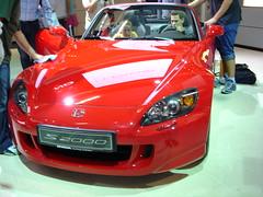 automobile(1.0), automotive exterior(1.0), wheel(1.0), vehicle(1.0), automotive design(1.0), auto show(1.0), honda(1.0), honda s2000(1.0), bumper(1.0), land vehicle(1.0), supercar(1.0), sports car(1.0),