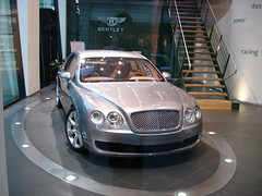 maybach 57(0.0), automobile(1.0), automotive exterior(1.0), executive car(1.0), wheel(1.0), vehicle(1.0), automotive design(1.0), bentley continental flying spur(1.0), auto show(1.0), bentley continental gt(1.0), sedan(1.0), land vehicle(1.0), luxury vehicle(1.0), bentley(1.0), supercar(1.0),