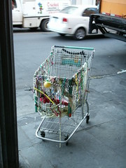 art(0.0), vehicle(1.0), glass(1.0), iron(1.0), shopping cart(1.0), cart(1.0),