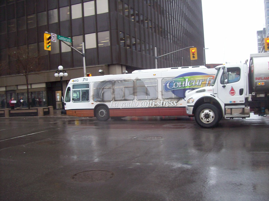 A STO Nova Bus LFS on Rideau Street in downtown Ottawa...