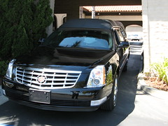 cadillac sts-v(0.0), cadillac cts(0.0), automobile(1.0), automotive exterior(1.0), executive car(1.0), cadillac(1.0), vehicle(1.0), cadillac dts(1.0), cadillac sts(1.0), grille(1.0), bumper(1.0), sedan(1.0), land vehicle(1.0), luxury vehicle(1.0),
