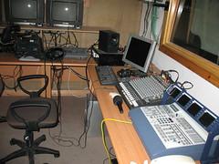 radio(0.0), audio engineer(0.0), furniture(1.0), room(1.0), personal computer(1.0), studio(1.0), recording(1.0), desk(1.0),