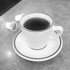 dishware(1.0), serveware(1.0), espresso(1.0), cup(1.0), tableware(1.0), saucer(1.0), monochrome photography(1.0), coffee cup(1.0), drink(1.0), black-and-white(1.0), caffeine(1.0),