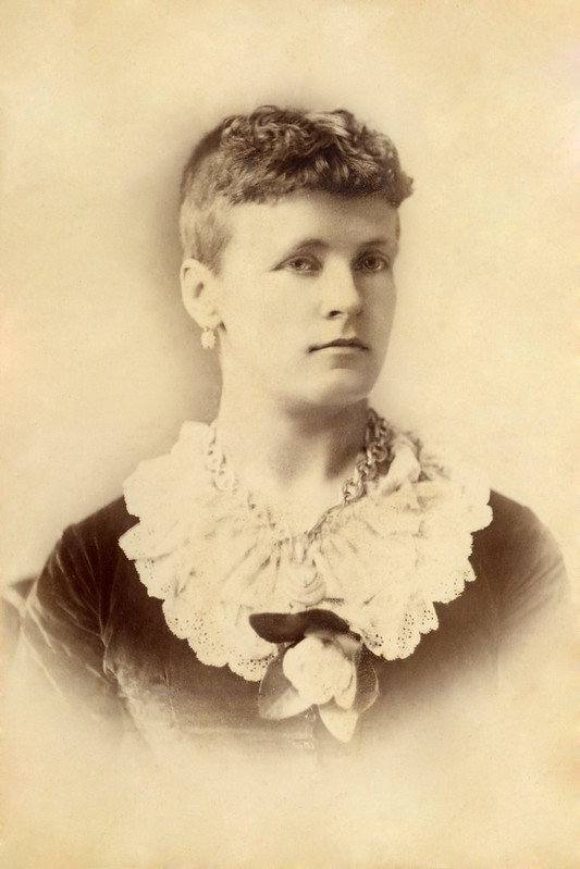 Unknown New Zealand Suffragette wearing a white camillia, symbol of NZ Women's Sufferage