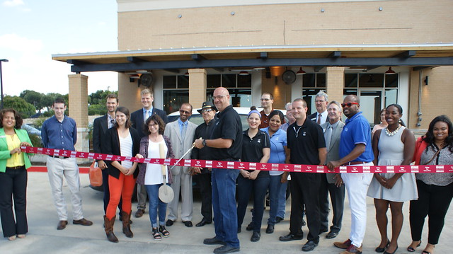 Spin Pizza Ribbon Cutting