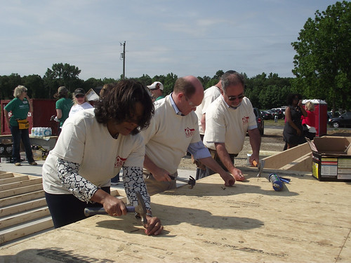 United States Senator Chris Coons (center) joining USDA Deputy Under Secretary for Rural Development (RD) Vernita Dore, RD's Delaware State Director Bill McGowan and dozens of RD and community volunteers to help build a home