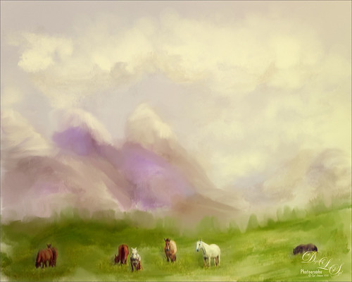 Image of grazing horses with painted mountains