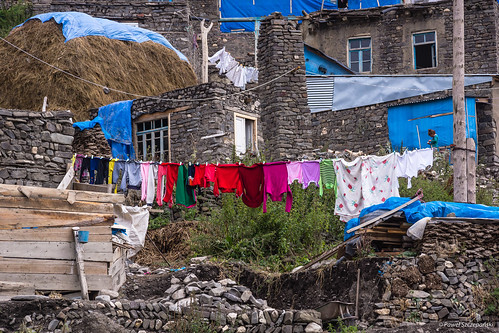 wood blue windows roof sun house mountains stone clouds cord bucket colorful asia doors barrel cottage dry cable azerbaijan pole highland hut laundry caucasus haystack electricity hay caucasian upland mountainous montane xinaliq azerbejdżan mountineers