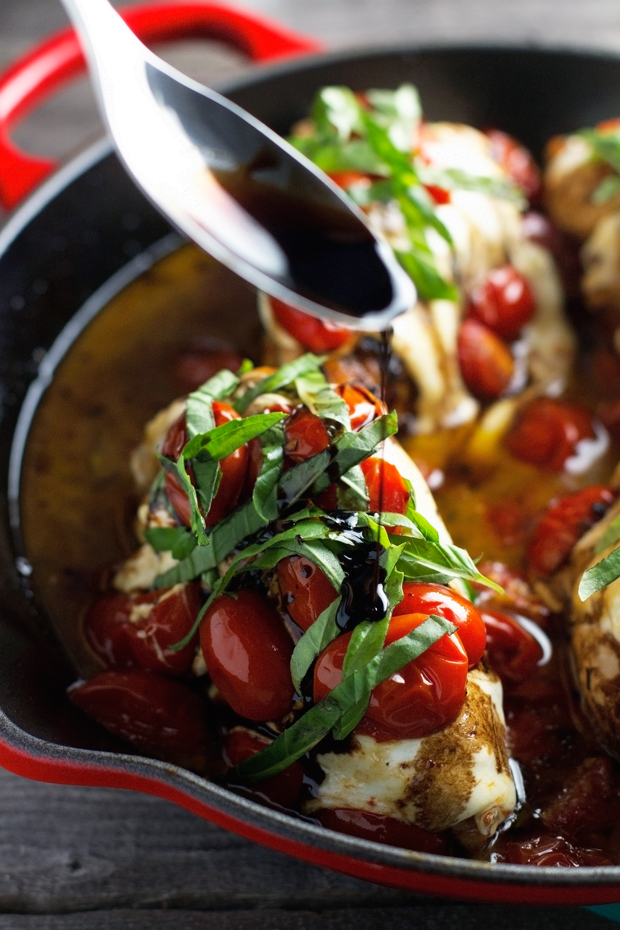Baked Caprese Chicken - with the most delicious balsamic reduction of your LIFE. Ready in under an hour and perfect and so DELICIOUS! #caprese #bakedcapresechicken #chickendinner #capresechicken | Littlespicejar.com