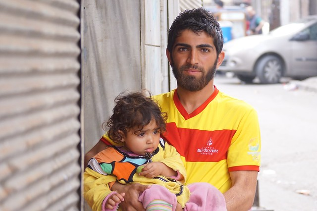 A Syrian refugee with daughter