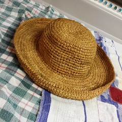 My favorite staw hat was accidentally crushed until it was almost unrecognizable. I rinsed it out and then dipped it in liquid starch. There's a wadded up paper bag inside.  Fingers crossed this works! #savemyhat