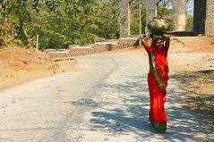 Indian lady carrying water, Central India