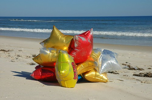 balloons on the beach by Alida's Photos