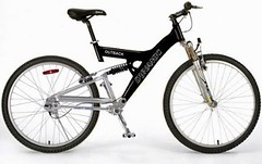 electric bicycle(0.0), bmx bike(0.0), hybrid bicycle(0.0), cyclo-cross bicycle(0.0), racing bicycle(0.0), mountain bike(1.0), road bicycle(1.0), wheel(1.0), vehicle(1.0), sports equipment(1.0), land vehicle(1.0), bicycle frame(1.0), bicycle(1.0),