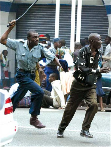 Zimbabwean police beats fleeing protester