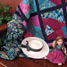 Hat, doll, and quilt