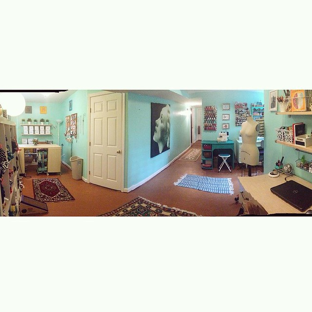 Taking photos of my sewing room is hard because it's such a funny shape! Here's a shitty panoramic to give you an idea of what I'm working with.