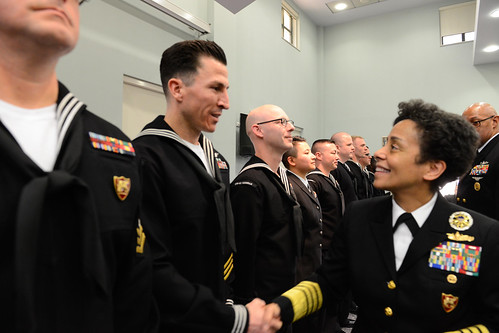 Fri, 01/27/2017 - 10:36 - 170127-N-SS492-553 NAVAL SUPPORT ACTIVITY NAPLES, Italy (Jan. 27, 2017) Commander, U.S. Naval Forces Europe-Africa, Adm. Michelle Howard, right, shakes hands with and presents a coin to Aircrew Survival Equipmentman  1st Class Nicholas Neal at the Commander, U.S. Naval Forces Europe-Africa Sailor of the Year ceremony Jan. 27, 2017.  U.S. Naval Forces Europe-Africa, headquartered in Naples, Italy, oversees joint and naval operations, often in concert with allied, joint, and interagency partners, to enable enduring relationships, and increase vigilance and resilience in Europe and Africa. (U.S. Navy photo by Chief Mass Communication Specialist Brian P. Biller/Released)