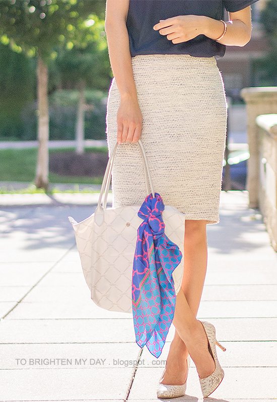 navy tee, tweed pencil skirt, blue chain scarf tied on white tote, snakeskin pumps
