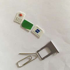 Most important tools of the modern international traveler: paperclip and a local SIM card.