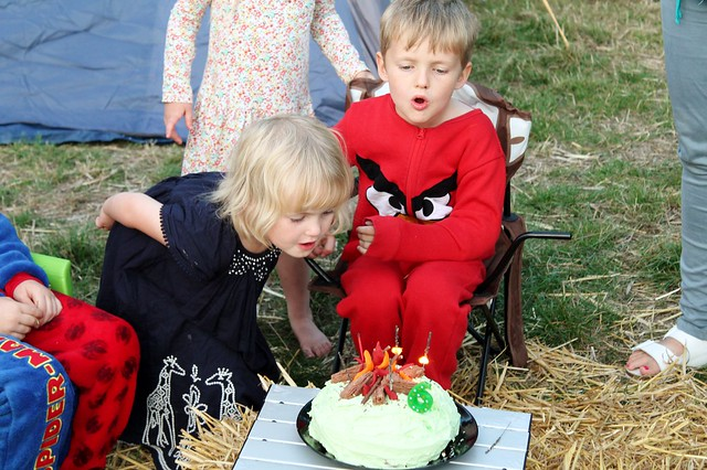 cake candle blowing out camping party sixth birthday