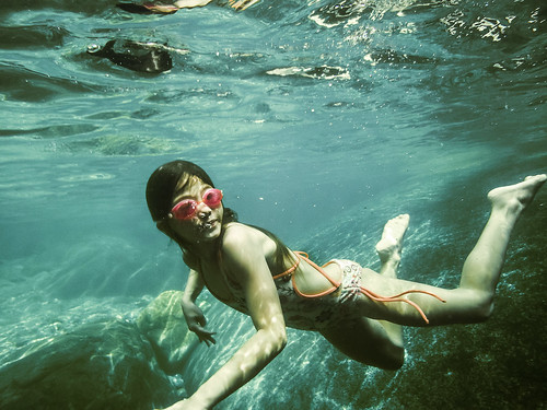 Seven Year Old Girl Swimming Underwater in Clear River Water