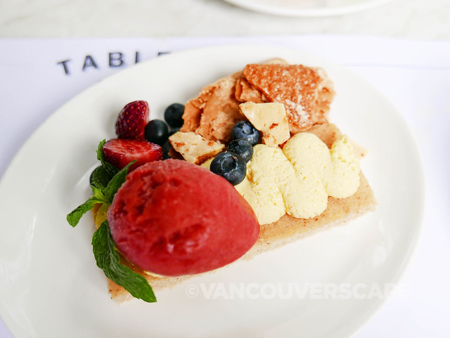 Berry financier with almond puff, fresh fruits, strawberry sorbet