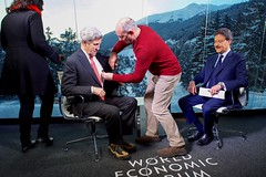 U.S. Secretary of State John Kerry gets a microphone before being interviewed by Sky Arabia host Muhammed Le on January 17, 2017, at the World Economic Forum in Davos, Switzerland. [State Department photo/ Public Domain]